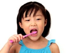stock-footage-little-girl-looks-at-camera-and-brushes-her-teeth.jpg